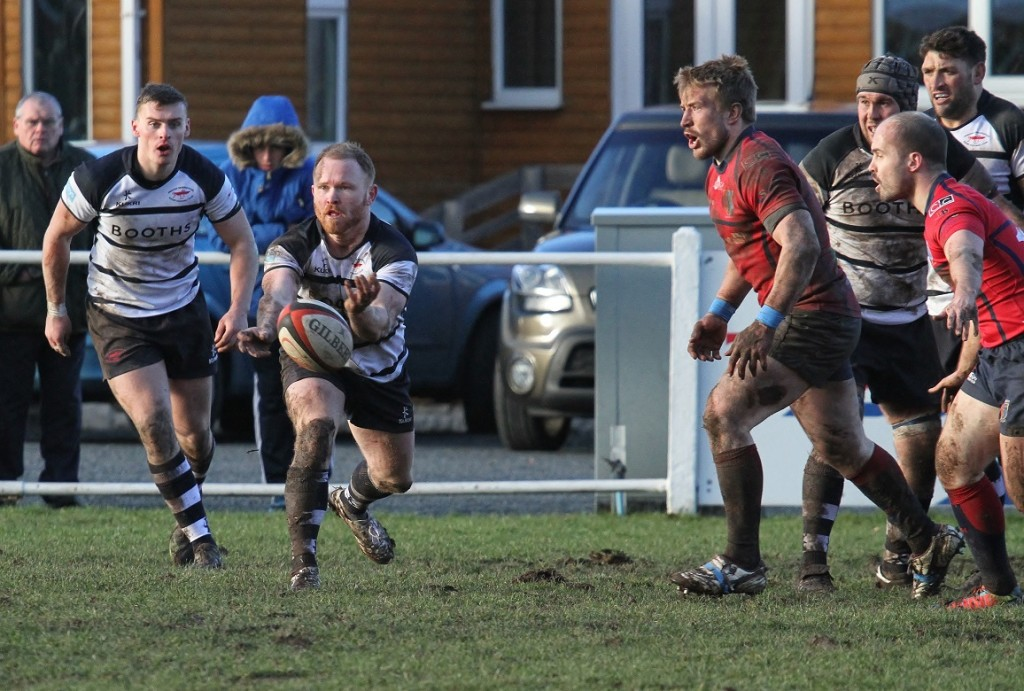 Sam Kindred gets the ball away