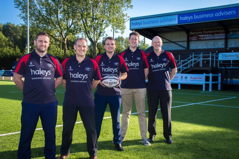 Pictured: Some of the Haleys team under their sponsorship boards.